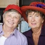 Two Senior Women Wearing Red Hats — Stock Photo #39769433