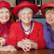 Three Senior Women Wearing Red Hats — Stock Photo #39769495