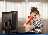Nerdy girl smashing her computer — Stock Photo