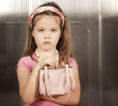 Little girl with pink purse — Stock Photo