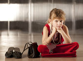 Sullen young girl in red — Stock Photo