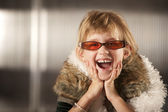 Cute young girl in red glasses — Stock Photo