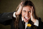 Handsome man in formalwear screaming — Stock Photo