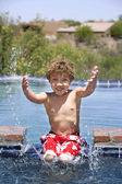 Boy Splashing in a Pool — Stock Photo
