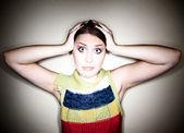 Cute Perplexed Girl in Spotlight — Stock Photo