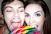Couple Biting into Lollipop — Stock Photo