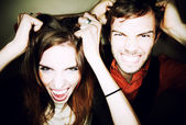 Couple tearing out their hair — Stockfoto