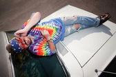 Hippie on a car Hood — Stock Photo