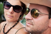 Couple wearing sunglasses — Stock Photo
