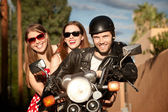 Trio posing on motorcycle — Stock Photo