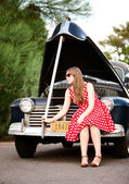Girl in red with vintage car — Stockfoto