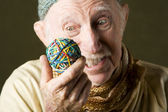 Man contemplating a rubber band ball — Stock Photo