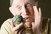 Man contemplating a rubber band ball — Stock Photo