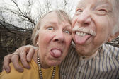 Crazy Couple Sticking Out Tongues — Stockfoto