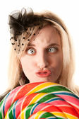 Pretty young woman with lollipop — Stock Photo