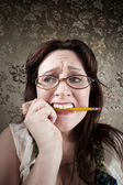 Nervous Woman Chewing on a Pencil — Stock Photo