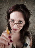 Curious woman pointing with pencil — Foto de Stock