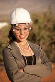 Young woman in hard hat and safety goggles — Stock Photo