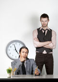 Bored man and angry coworker — Stock Photo