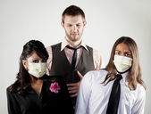 Sick man and worried coworkers in masks — Stock Photo