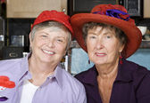 Two Senior Women Wearing Red Hats — Stockfoto