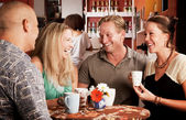 Friends in a Coffee House — Stockfoto