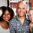Man with three pretty women in coffee house — Stock Photo