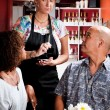 Woman taking order from couple in coffee house — Stock Photo #39770161