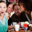 Four Friends Gossiping in a Coffee House — Stock Photo