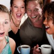 Four Friends Gossiping in a Coffee House — Stock Photo #39770287