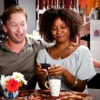 Mixed Race Couple with Handheld Phone — Stock Photo