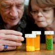Man and woman looking at prescription medications — Stock Photo