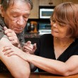 Man and woman with small hypodermic needle — Stock Photo #39774767