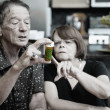 Couple at Home with Medication — стоковое фото #39775515