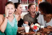 Four Friends Gossiping in a Coffee House — Stockfoto