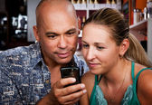 Couple in Coffee House with Cell Phone — Stock Photo
