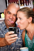 Couple in Coffee House Taking Self-Portrait with Cell Phone — Stock Photo