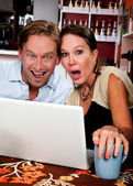 Couple in Coffee House with Laptop Computer — Stockfoto