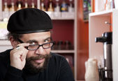 Man wearing beret in coffee house — Stok fotoğraf