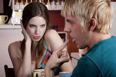 Woman flirting with male friend — Stock Photo