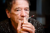 Man with small hypodermic needle — Stock Photo