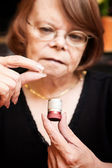 Woman with small pill and case — Stock Photo