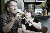 Couple at Home with Medication — Stock Photo