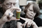 Senior Couple at Home with Prescription — Stock Photo