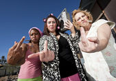 Three Trashy Women making a Rude Gesture — Stock Photo