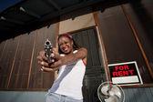 Woman with Gun — Stock Photo