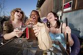 Three women drinking alcohol — Stock Photo