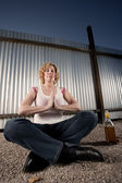 Smoking and drinking woman meditating — Stockfoto