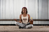 Cigar smoking and drinking woman meditating — Stock Photo