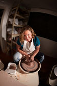 Fisheye shot of potter shaping clay — Stock Photo